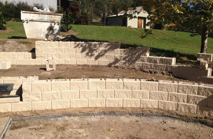 Retaining & Retention Walls-Rowlett TX Professional Landscapers & Outdoor Living Designs-We offer Landscape Design, Outdoor Patios & Pergolas, Outdoor Living Spaces, Stonescapes, Residential & Commercial Landscaping, Irrigation Installation & Repairs, Drainage Systems, Landscape Lighting, Outdoor Living Spaces, Tree Service, Lawn Service, and more.